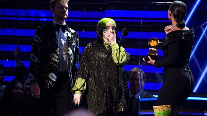 Billie Eilish posing with her GRAMMY is the cutest thing right now
