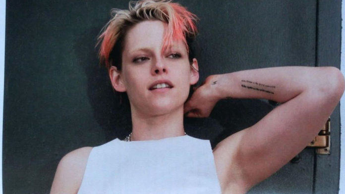 Kristen Stewart looks like an androgynous tomboy with short orange hair