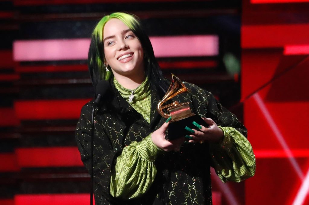 Billie Eilish is all Gucci posing Green and Black with GRAMMY.
