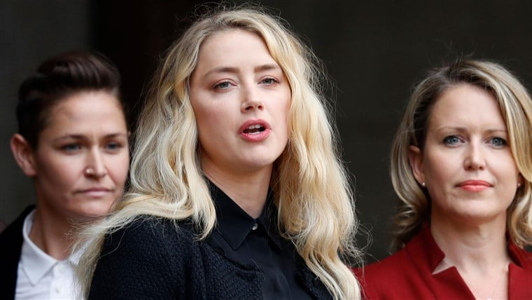 Amber Heard with her legal team during The Sun libel case in the United Kingdom.