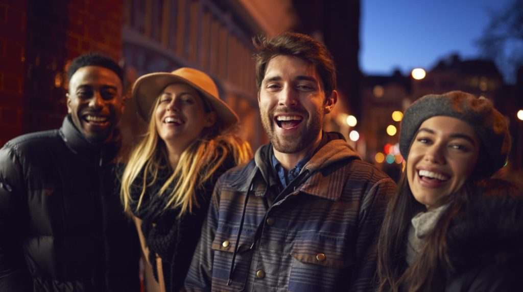 Portrait Of Group Of Friends In City Outdoors On Night Out Together